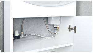Ogrzewacz Dafi w wersji z nyplami zapewnia możliwosć montażu pod umywalką